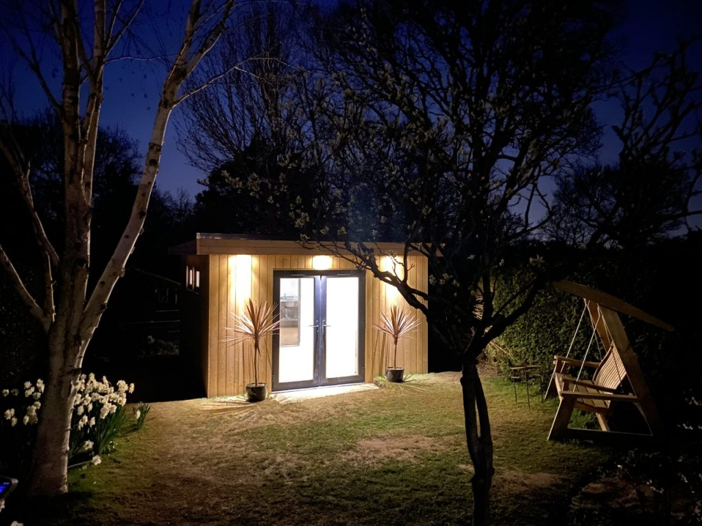 Garden room at nights with lights on