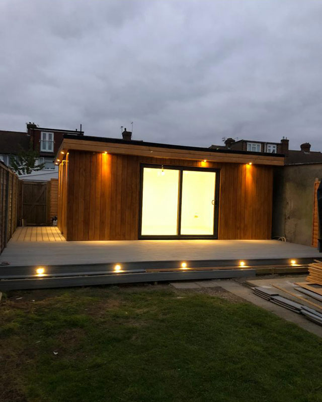Insulated wooden garden room with exterior light